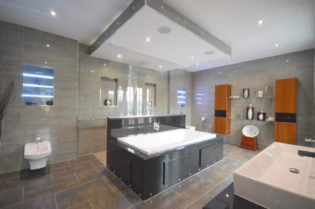Tile flooring installed throughout the bathroom, large format tile flooring,