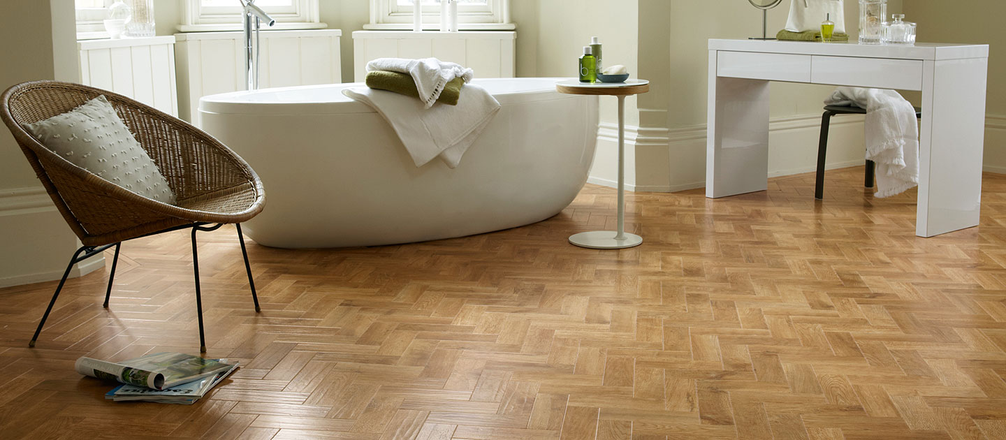 Luxury vinyl in a herringbone pattern installed in a modern open style, luxury bathroom