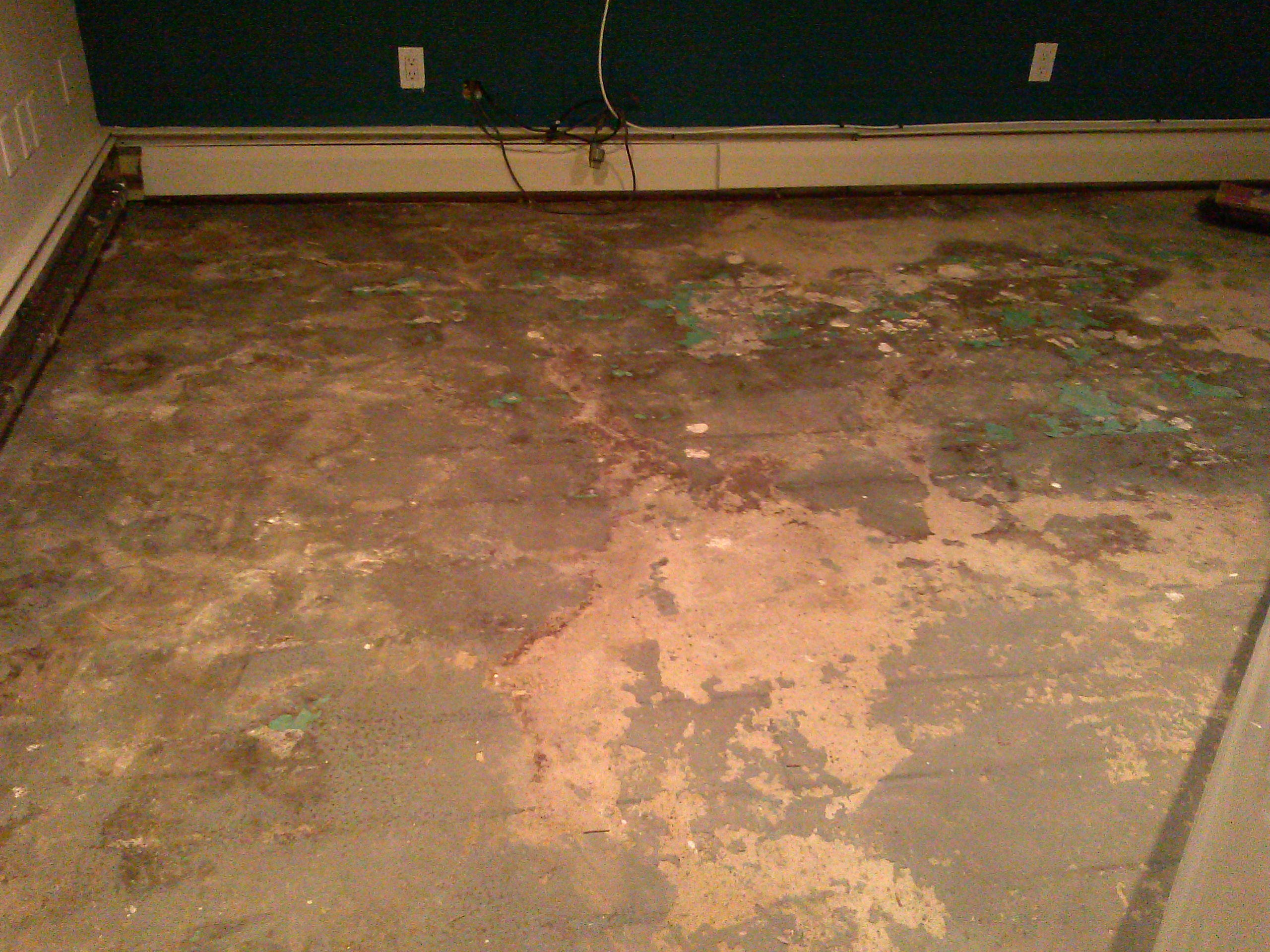 Basement slab needing prep-work for new finishes